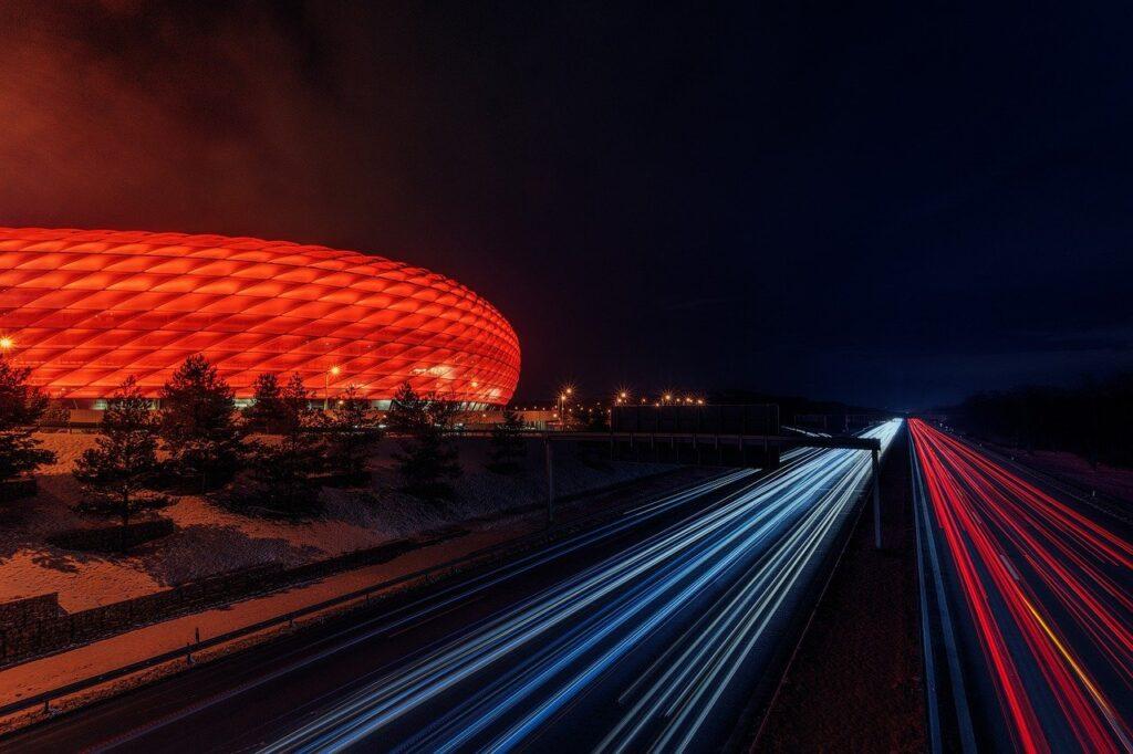 football stadium, highway, night